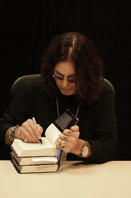 Ozzy Osbourne, signing at the store in February 2010